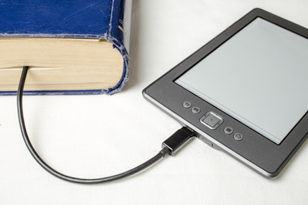 eBook connected to the old thick blue book with a cable, and download information from there on a light background